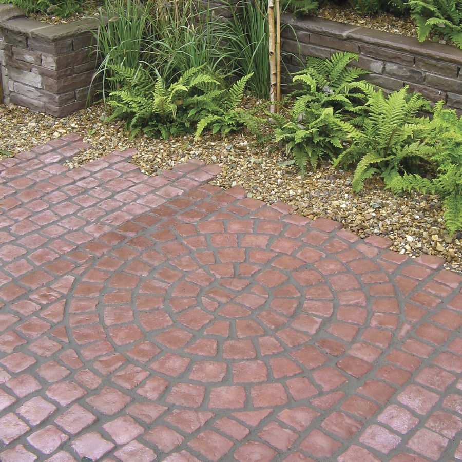 Carpet stones cobble circle for Garden paving designs